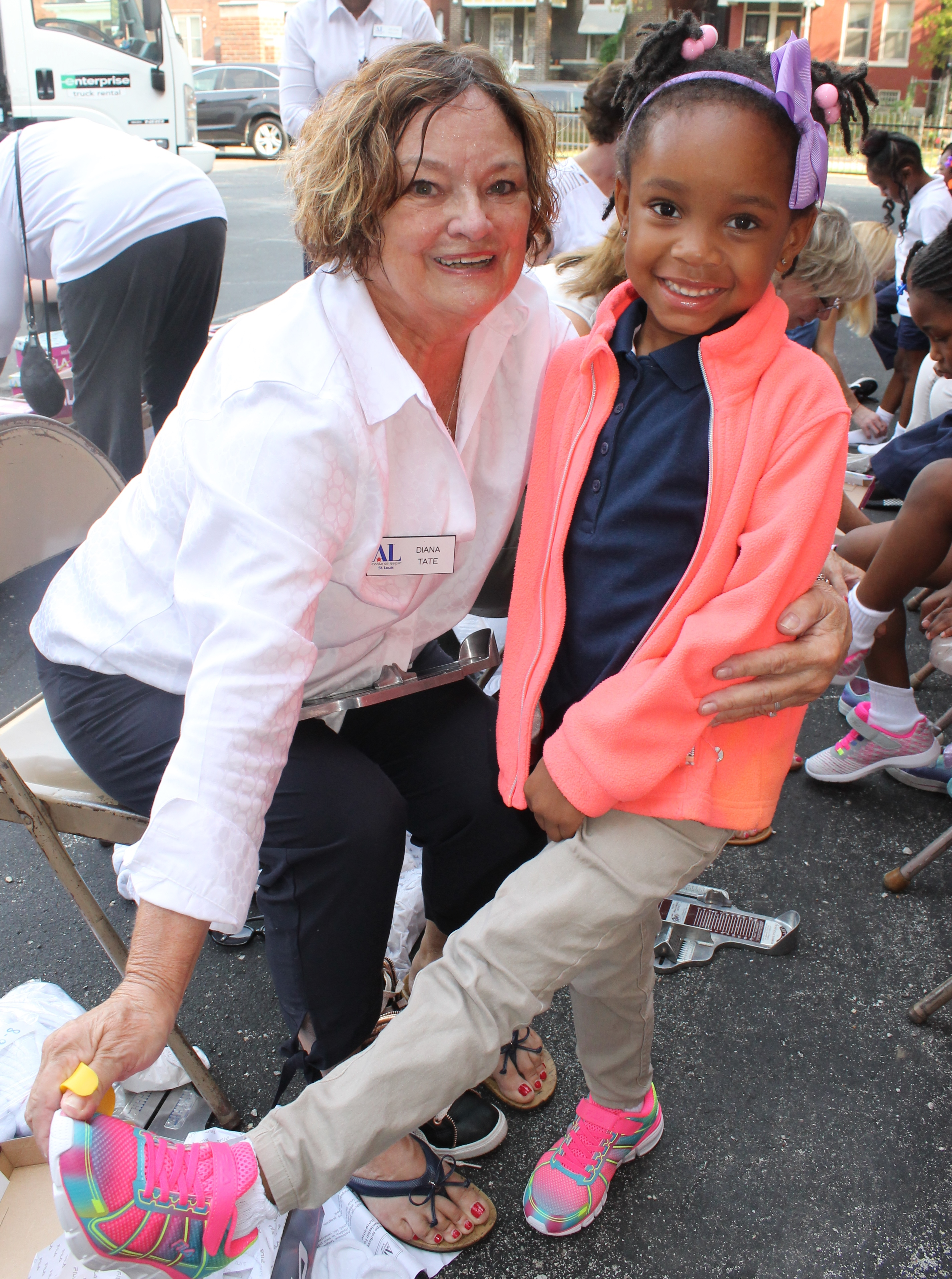 9 10 19 STEPS Diana Tate of Ballwin with Hamilton School kindergartener showing off her shoes